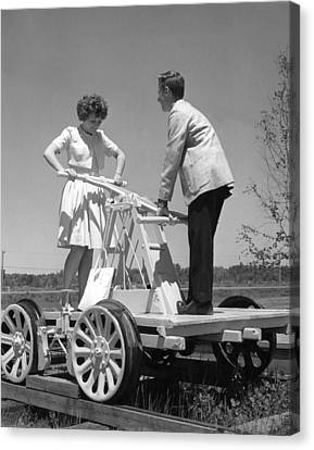 Land Feature Canvas Print - Couple Powers A Railroad Cart by Underwood Archives