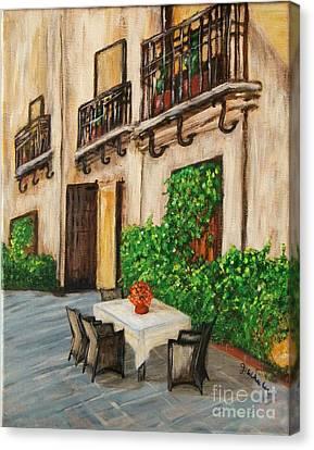 Courtyard Seating Canvas Print by JoAnn Wheeler