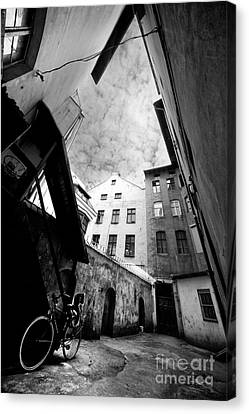 Courtyard With Bike And Buildings In Black And White Canvas Print