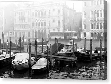 Covered Boats In Venice Canvas Print by John Rizzuto