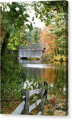 Covered Bridge Over The Lake Canvas Print by Vinnie Oakes