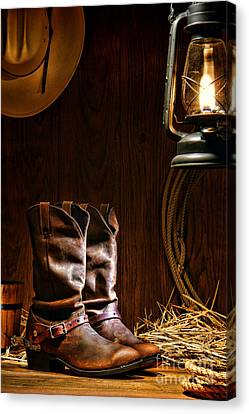 Rodeo Canvas Print - Cowboy Boots At The Ranch by Olivier Le Queinec
