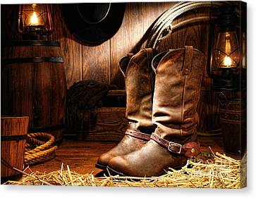 Oil Lamp Canvas Print - Cowboy Boots In A Ranch Barn by Olivier Le Queinec