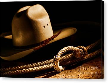 Cowboy Hat And Lasso Canvas Print by Olivier Le Queinec