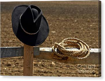 Cowboy Hat And Rope On Fence Canvas Print by Olivier Le Queinec