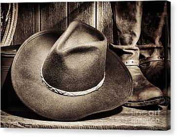 Cowboy Hat On Floor Canvas Print by Olivier Le Queinec