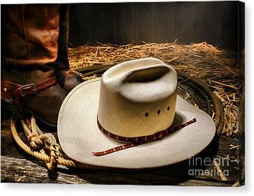 Cowboy Hat On Lasso Canvas Print by Olivier Le Queinec