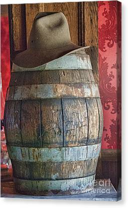 Pioneers Canvas Print - Cowboy Hat On Old Wooden Keg by Juli Scalzi