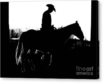 Canvas Print featuring the photograph Cowboy Rides Home In Silhouette by Lincoln Rogers