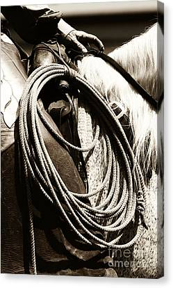 Canvas Print featuring the photograph Cowboy Rides To Work by Lincoln Rogers