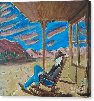 Cowboy Sitting In Chair At Sundown Canvas Print by John Lyes