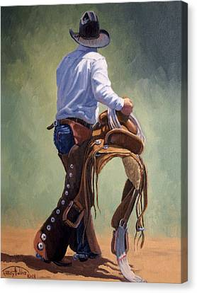 Cowboy With Saddle Canvas Print by Randy Follis