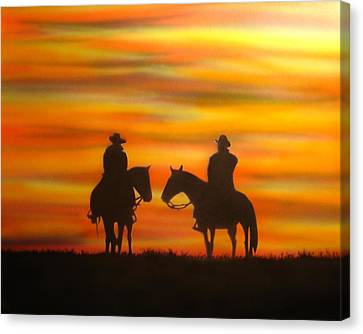 Cowboys At Sunset Canvas Print by Chris Fraser