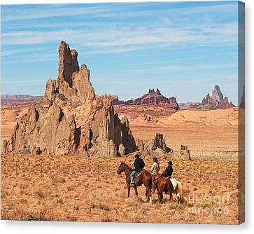 Cowboys Canvas Print by Bob and Nancy Kendrick