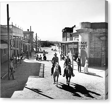 Cowboys Come Into Town Canvas Print by Retro Images Archive
