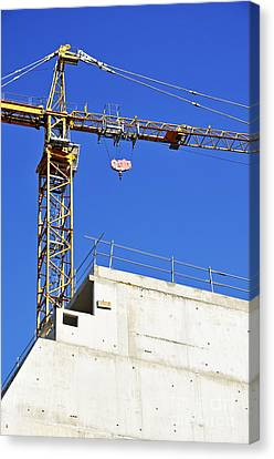 Crane On Construction Site Canvas Print by Sami Sarkis