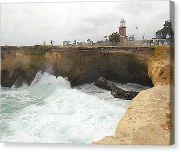 Crashing Surf Near The Lighthouse Canvas Print by Ron Regalado