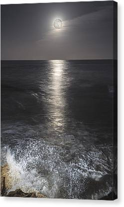 Crashing With The Moon Canvas Print by Bryan Toro