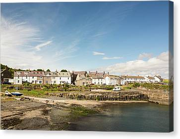 Craster Village And Harbour Canvas Print by Ashley Cooper