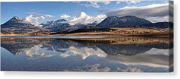 Crawford Reservoir And The West Elk Mountains Canvas Print by Eric Rundle