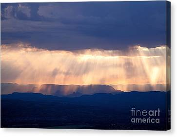 Canvas Print featuring the photograph Crepuscular Light Rays Just After Sunrise On Sedona Arizona As Seen From Jerome by Ron Chilston