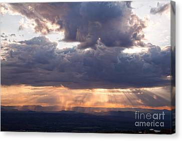Canvas Print featuring the photograph Crepuscular Light Rays Over Sedona From Jerome Arizona by Ron Chilston