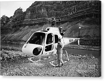 Crew Member Calling Passengers Forward For Boarding Papillon Helicopter Tours Landed On Pad Down In  Canvas Print by Joe Fox
