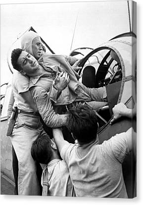 Crewmen Lift A Wounded Pilot Canvas Print