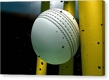 Cricket Ball Striking Wickets With Particles At Night Canvas Print by Allan Swart