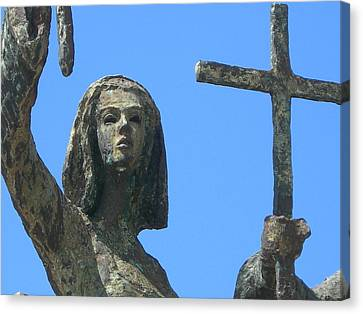Cross Against The Sky Canvas Print by Loretta Cassiano