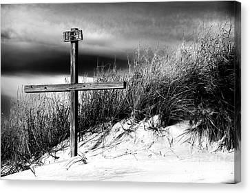 Cross At Sunset Beach Canvas Print by John Rizzuto