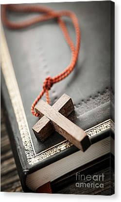 Cross On Bible Canvas Print