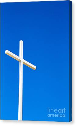 Cross On Blue Sky Canvas Print