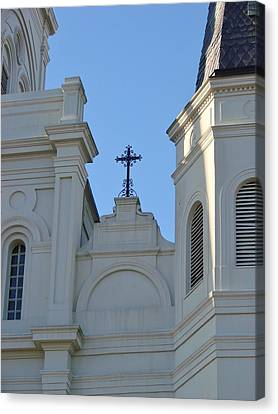 Cross On The Cathedral Canvas Print by Margaret Bobb