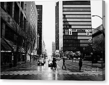 crosswalk at west georgia and hornby downtown in the rain Vancouver BC Canada Canvas Print by Joe Fox