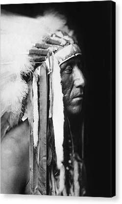 Crow Indian Man Circa 1905 Canvas Print by Aged Pixel