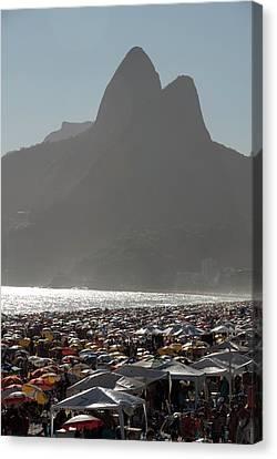 Crowded Ipanema Beach Scene, Rio De Canvas Print by Kevin Berne