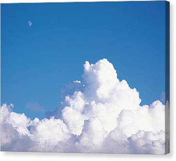 Cumulus Clouds And Moon In Sky Canvas Print