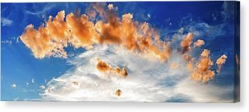 Cumulus Clouds At Sunset Canvas Print by Babak Tafreshi