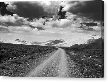 Curving Road Into The Mountains Canvas Print by Eric Benjamin