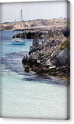 In Cala Pudent Menorca The Cutting Rocks In Contrast With Turquoise Sea Show Us An Awsome Place Canvas Print by Pedro Cardona