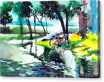 Cycle In The Puddle Canvas Print by Anil Nene