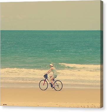 Cycling In Beach Canvas Print by Girish J