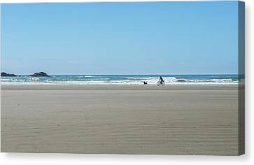 Cyclist And Dog On Long Beach, Pacific Canvas Print