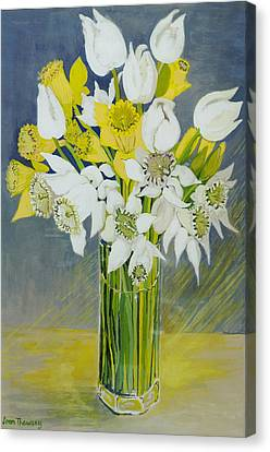 Daffodils And White Tulips In An Octagonal Glass Vase Canvas Print by Joan Thewsey