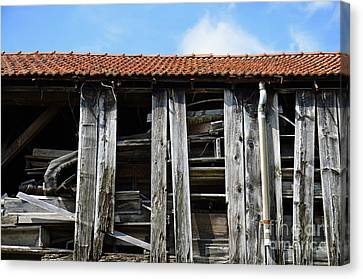 Damaged Old Wooden Building Canvas Print by Sami Sarkis