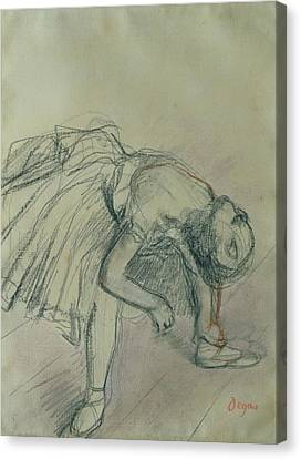 Dancer Fixing Her Slipper Canvas Print by Edgar Degas