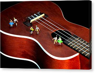 Dancing Party On A Guitar Canvas Print by Paul Ge