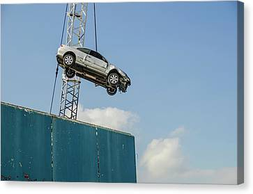 Dangling Car Canvas Print by Robert Brook