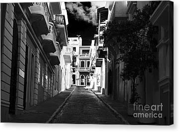 Dark Alley In San Juan Canvas Print by John Rizzuto